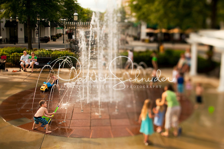 Residents and visitors enjoy Birkdale Village, a mixed-use residential and retail center in Huntersville, NC, located 12 miles north of Charlotte, NC. Considered an urban mixed-use community, Birkdale Village has restaurants, stores, cafes, a movie theater, single-family houses, as well as apartments and condos built above retail. Children enjoy playing in the water fountain located in the center of Birkdale Village.