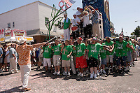 Brooklyn New York - 13 July 2008 - DANMCE OF THE GIGLIO- 120 Italian American men, adorned in the colors of the Italian Flag, carry the Giglio, and a similarly size boat, through theconfetti covered streets of WIlliamsburg, Brooklyn.  The Giglio and the boat meet, at the intersection of Havemeyer and North 8th Street, to mark the Feast Day of fifth Century Saint Paulino, of Nola Italy.