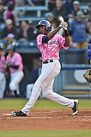 Asheville Tourists first baseman Correlle Prime #32 swings at a pitch during a game against the  Lexington Legends at McCormick Field on May 16, 2014 in Asheville, North Carolina. The Tourists defeated the Legends 11-1. (Tony Farlow/Four Seam Images)