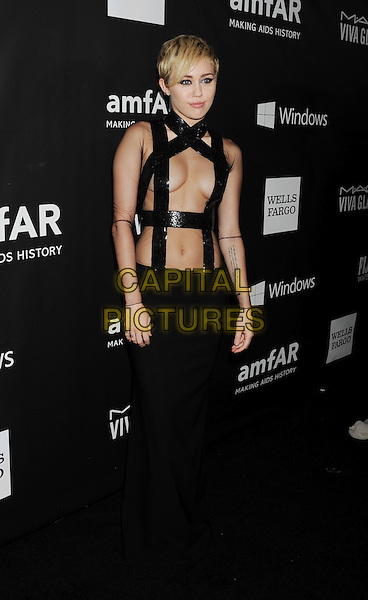 HOLLYWOOD, CA- OCTOBER 29: Recording artist Miley Cyrus  attends amfAR LA Inspiration Gala honoring Tom Ford at Milk Studios on October 29, 2014 in Hollywood, California.<br /> CAP/ROT/TM<br /> &copy;TM/ROT/Capital Pictures
