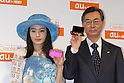 Actress Yukie Nakama and Tadashi Onodera, President and Chairman of KDDI  pose for the press, holding mobile carrier au's new mobile handsets for the spring season. 19 January, 2009. (Taro Fujimoto/JapanToday/Nippon News) TOKYO --<br /> <br /> Mobile carrier KDDI au on Thursday unveiled 12 new mobile handsets for the spring season. The new handsets are made by Sony Ericsson, Hitachi, Toshiba, Casio, Sharp, Panasonic, Kyocera for consumers and HCT for corporate users.