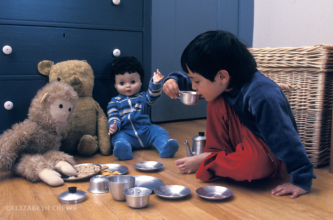 Berkeley CA Boy 3 1/2 years old having a fantasy tea party with dolls and stuffed animals MR