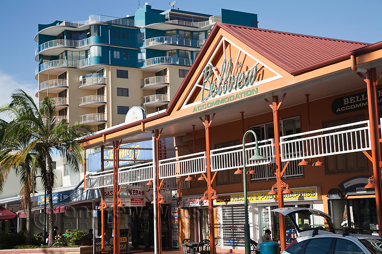 Accommodation and shops on the Esplanade.  Cairns, Queensland, Australia