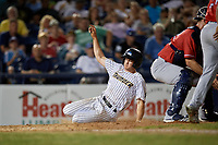 Trenton Thunder Kyle Holder (6) slides home during an Eastern League game against the New Hampshire Fisher Cats on August 20, 2019 at Arm & Hammer Park in Trenton, New Jersey.  New Hampshire defeated Trenton 7-2.  (Mike Janes/Four Seam Images)