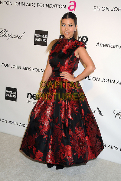 Kourtney Kardashian.21st Annual Elton John Academy Awards Viewing Party held at West Hollywood Park, West Hollywood, California, USA..February 24th, 2013.oscars full length dress hand on hip red black embroidered floral print .CAP/ADM/BP.©Byron Purvis/AdMedia/Capital Pictures.