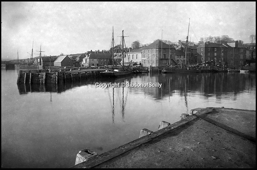 BNPS.co.uk (01202 558833)<br /> Pic: GibsonOfScilly/BNPS<br /> <br /> Padstow around 1900.<br /> <br /> An archive of eye-opening photographs documenting the grim reality of Poldark's Cornwall has emerged for sale for &pound;25,000.<br /> <br /> More than 1,500 black and white images show the gritty lives lived by poverty-stricken families in late 19th and early 20th century Cornwall - around the same time that Winston Graham's famous Poldark novels were set.<br /> <br /> The collection reveals the lowly beginnings of towns like Rock, Fowey, Newquay and St Ives long before they became picture-postcard tourist hotspots.<br /> <br /> Images show young filth-covered children playing barefoot in squalid streets, impoverished families standing around outside the local tax office, and weather-beaten fishwives tending to the day's catch.<br /> <br /> The Cornish archive, comprising 1,200 original photographic prints and 300 glass negative plates, is tipped to fetch &pound;25,000 when it goes under the hammer as one lot at Penzance Auction House.