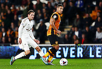 Jake Livermore of Hull City and Gylfi Sigurosson of Swansea City during the Capital One Cup match between Hull City and Swansea City played at the Kingston Communications Stadium, Hull