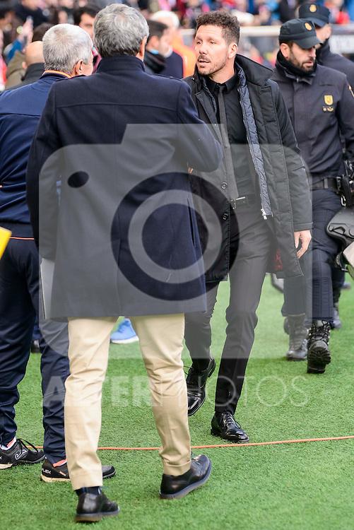 Atletico de Madrid Diego Pablo Simeone and UD Las Palmas Quique Setien during La Liga match between Atletico de Madrid and UD Las Palmas at Vicente Calderon Stadium in Madrid, Spain. December 17, 2016. (ALTERPHOTOS/BorjaB.Hojas)