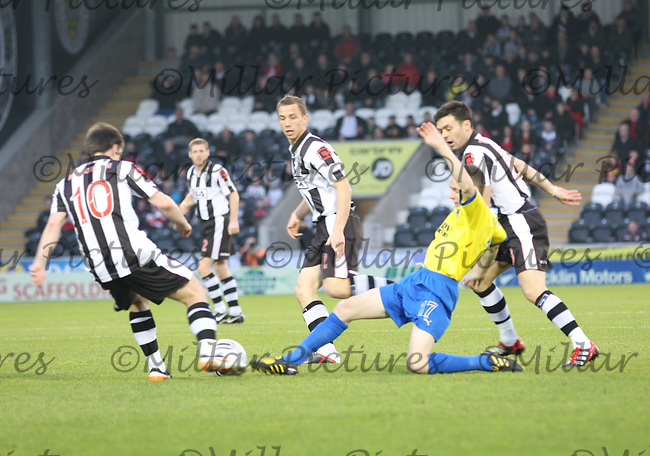 Paul McGowan (left) on the ball as Paul Burns (centre) slides in in the St Mirren v Dunfermline Athletic Clydesdale Bank Scottish Premier League match played at New St Mirren Park, Paisley on 19.11.11.