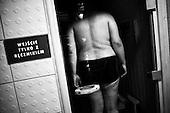 Krotoszyn 03.10.2010 Poland<br /> Polish team sumo players while relaxing in the pool.<br /> Poles do not know much about sumo. Japan's national sport remains a mystery, except for the image of the very big and fat sumo wrestlers. However Polish sumo wrestlers have been, for many years, classified among world's leading sportsmen in this field. Since 1995 more and more followers join the sumo sections, fascinated with the art of fighting on the clay dohyo.<br /> Photo: Adam Lach / Napo Images<br /> <br /> Zawodnicy polskiej kadry podczas odpoczynku na basenie.<br /> Polacy niewiele wiedza o sumo. Narodowy sport Japonii to wciaz tajemnica. Kojarzy sie jedynie z wielkimi i grubymi mezczyznami. Jednak zawodnicy z Polski od lat naleza do swiatowej czolowki w tej dyscyplinie. Od 1995 roku w sekcjach sumo przybywa zawodnik&oacute;w zafascynowanych zmaganiami na glinianym dohyo.<br /> Fot: Adam Lach / Napo Images
