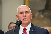 United States Vice President Mike Pence speaks before US President Donald J. Trump signs the Presidential Space Directive - 1, directing NASA to return to the moon, alongside members of the Senate, Congress, NASA, and commercial space companies in the Roosevelt Room of the White House in Washington, Monday, December 11, 2017.<br /> Mandatory Credit: Aubrey Gemignani / NASA via CNP
