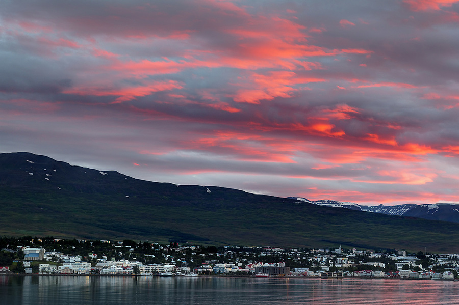 Sunset illuminated clouds over Akureyri, North Iceland, Iceland