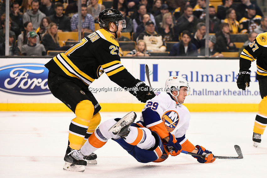 February 7, 2015 - Boston, Massachusetts, U.S. -  Boston Bruins defenseman Dougie Hamilton (27) gives New York Islanders center Brock Nelson (29) a shove during the NHL game between the New York Islanders and the Boston Bruins held at TD Garden in Boston Massachusetts.   Eric Canha/CSM