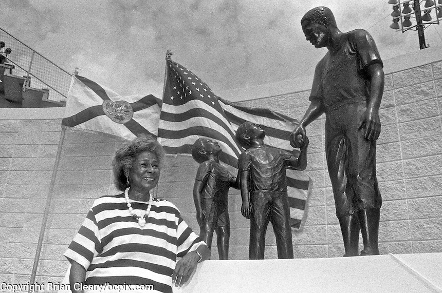 Rachel Robinson, the widdow of baseball hall-of-famer Jackie Robinson, stands next to a statue of her late husband at the dedication of the statue of Jackie Robinson outside the entrance to Jackie Robinson Ballpark, Daytona Beach, FL, October 1990.  (Photo by Brian Cleary/www.bcpix.com)
