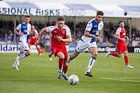 Wes Burns of Fleetwood Town gets away from Ryan Sweeney of Bristol Rovers during the Sky Bet League 1 match between Bristol Rovers and Fleetwood Town at the Memorial Stadium, Bristol, England on 26 August 2017. Photo by Mark  Hawkins.