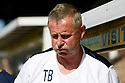 AFC Wimbledon manager Terry Brown feels the heat during the Blue Square Bet Premier match between Cambridge United and AFC Wimbledon at the Abbey Stadium, Cambridge on 9th April, 2011.© Kevin Coleman 2011.