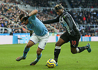 30th November 2019; St James Park, Newcastle, Tyne and Wear, England; English Premier League Football, Newcastle United versus Manchester City;  Gabriel Jesus of Manchester City tries to go past Allan Saint-Maximin of Newcastle United  - Strictly Editorial Use Only. No use with unauthorized audio, video, data, fixture lists, club/league logos or 'live' services. Online in-match use limited to 120 images, no video emulation. No use in betting, games or single club/league/player publications