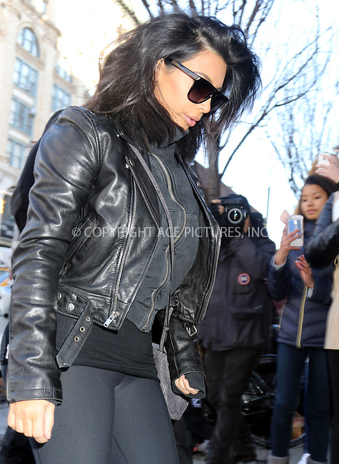 WWW.ACEPIXS.COM<br /> <br /> February 11 2015, New York City<br /> <br /> Kim Kardashian left her downtown apartment to take pictures of the Adidas Store in Soho on February 11 2015 in New York City<br /> <br /> By Line: Philip Vaughan/ACE Pictures<br /> <br /> ACE Pictures, Inc.<br /> tel: 646 769 0430<br /> Email: info@acepixs.com<br /> www.acepixs.com