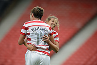 Glasgow, Scotland - Saturday, July 28, 2012:  Abby Wambach of the USA Women's soccer team celebrates with Tobin Heath, right, after scoring a goal during a 3-0 win over Colombia in the first round of the Olympic football tournament at Hamden Park.