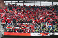 SEATTLE, WA - NOVEMBER 10: Toronto FC fans hold up their scarves while O Canada, the Canadian national anthem, is played during a game between Toronto FC and Seattle Sounders FC at CenturyLink Field on November 10, 2019 in Seattle, Washington.