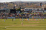 Newport County 1 Exeter City 1, 16/03/2014. Rodney Parade, League Two. Newport County finally return to the Football league after years of turmoil but a poor run of results has dented hopes of reaching the play-offs while Exeter City battle relegation. Newport town centre and the welsh hills provide a backdrop to the action at Rodney Parade. Photo by Simon Gill