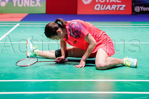 18th March 2018, Arena Birmingham, Birmingham, England; Yonex All England Open Badminton Championships; Zheng Siwei (CHN) and Huang Yaqiong (CHN) is floored after missing a shot in the mixed doubles  final against Yuta Watanabe (JPN) and Arisa Higashino (JPN)