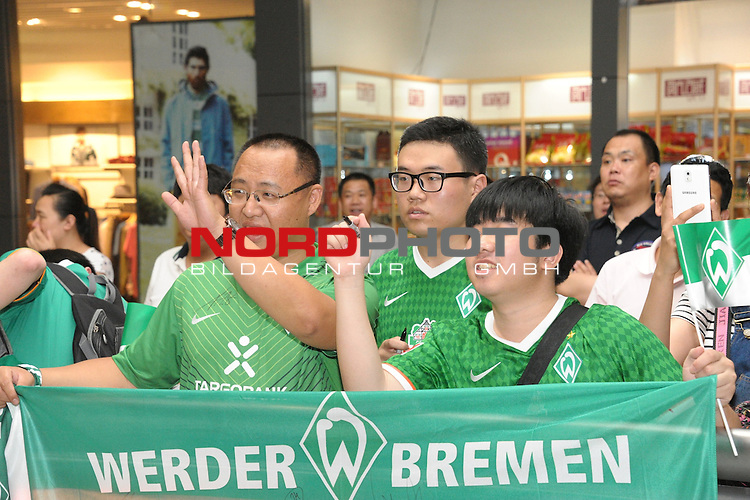 01.07.2014, Airport, Changchun, GER, <br /> <br /> Twenty-eight years after their first and until now only trip to the Far East, SV Werder Bremen arrives at Changchun Longjia International Airport and kicks off their Tour of China.<br /> <br /> Fans<br /> <br /> <br /> <br /> Foto &copy; nordphoto /  KB