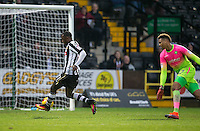 Jonathan Forte of Notts Co takes the ball around Goalkeeper Jamal Blackman of Wycombe Wanderers during the Sky Bet League 2 match between Notts County and Wycombe Wanderers at Meadow Lane, Nottingham, England on 10 December 2016. Photo by Andy Rowland.