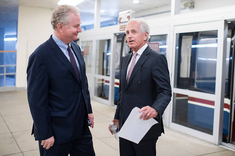 UNITED STATES - JULY 11: Sens. Chris Van Hollen, D-Md., left, and Bob Corker, R-Tenn., talk in the Capitol's Senate subway on July 11, 2018. (Photo By Tom Williams/CQ Roll Call)