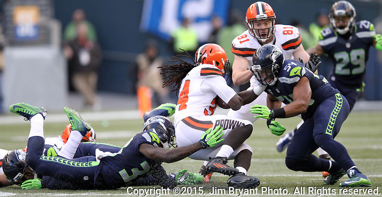 Seattle Seahawks strong safety Kelcie McCray (33) and  linebacker Bobby Wagner (54) stops Cleveland Browns running back Isaiah Crowell (34) at CenturyLink Field in Seattle, Washington on December 20, 2015. The Seahawks clinched their fourth straight playoff berth in four seasons by beating the Browns 30-13.  ©2015. Jim Bryant Photo. All Rights Reserved.