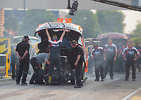 May 31, 2019; Joliet, IL, USA; Crew members for NHRA funny car driver Jeff Arend during qualifying for the Route 66 Nationals at Route 66 Raceway. Mandatory Credit: Mark J. Rebilas-USA TODAY Sports