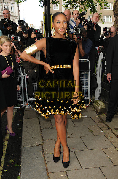ALEXANDRA BURKE .Glamour Women Of The Year Awards - Outside Arrivals, Berkeley Square Gardens, London, England, UK, .June 8th 2010..full length black dress gold embellished beaded hand on hip sleeveless shoes arm cuff .CAP/CAS.©Bob Cass/Capital Pictures.