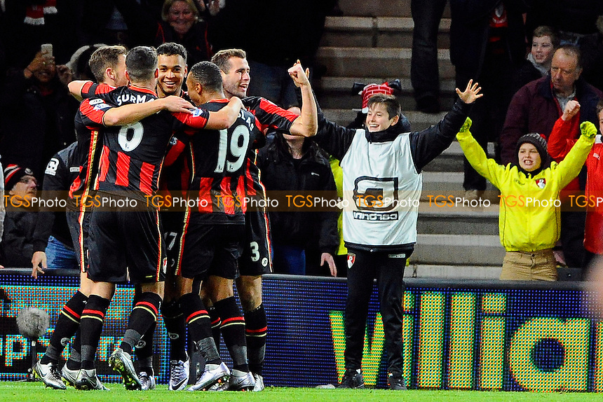 Joshua King of AFC Bournemouth middle of group is mobbed after scoring to make the score 2-1 during AFC Bournemouth vs Manchester United at the Vitality Stadium