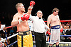 Tyson Fury (gold shorts) defeats John McDermott to win the English Heavyweight Boxing Title at the Brentwood Centre, Essex,