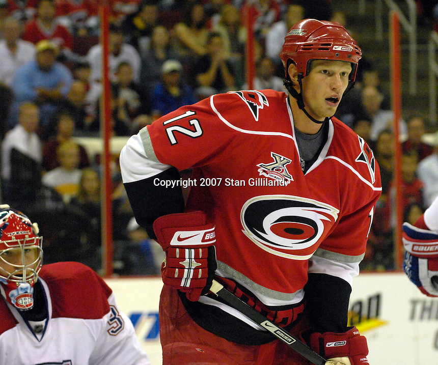 Carolina Hurricanes' Eric Staal (12) stands in the Montreal Canadiens' crease during their game Friday, Oct. 26, 2007 in Raleigh, NC. The Canadiens won 7-4.