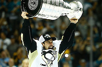 Sidney Crosby #87 of the Pittsburgh Penguins hoists the Stanley Cup following their 3-1 win against the San Jose Sharks during game six of the Stanley Cup Final at SAP Center in San Jose, California on June 12, 2016. (Photo by Jared Wickerham / DKPS)