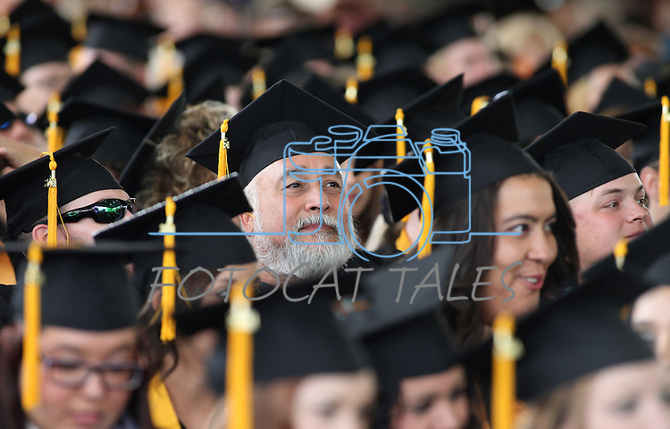 James Rocha listens to the Western Nevada College commencement ceremony at the Pony Express Pavilion, in Carson City, Nev., on Monday, May 19, 2014. A record-high 543 students graduate from WNC this week. <br /> Photo by Cathleen Allison/Nevada Photo Source