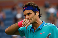 Roger Federer of Switzerland reacts after missing a point against Marin Cilic of Croatia during men semifinal match at the US Open 2014 tennis tournament in the USTA Billie Jean King National Center, New York.  09.05.2014. VIEWpress
