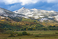An early snowstorm blankets the peaks above Strawberry Park in Steamboat Springs, Colorado.