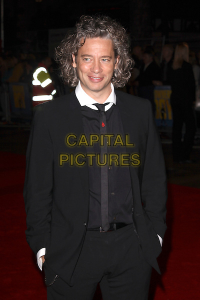 "DEXTER FLETCHER .The closing gala premiere of ""Nowhere Boy"" during the The Times BFI London Film Festival, Odeon Leicester Square, London, England..October 29th, 2009 .LFF half length black suit hands in pockets tie.CAP/AH.©Adam Houghton/Capital Pictures."