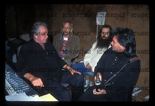 """JOHNNY CASH - Johnny Cash, Tom Petty, Rick Rubin and Marty Stuart during the recording sessions for Johnny Cash's """"Unchained"""" CD Produced by Rick Rubin.   Photographed at Sound City Studios in Van Nuys, CA USA - January 26, 1996.  Photo © Kevin Estrada / Iconicpix"""