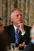 Governor Terry McAuliffe (Democrat of Virginia) listens to United States President Barack Obama speak to the National Governors Association in the State Dining Room of the White House in Washington, DC, USA, 24 February 2014. The governors are in DC for their winter meeting.<br /> Credit: Jim LoScalzo / Pool via CNP