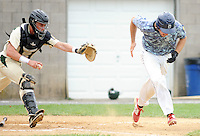 Pennridge catcher Jeff Roedell attempts to tag out Doylestown's Sam Andris after a dropped strike three in the third inning before throwing to first for the put out at Quakertown Memorial Park Sunday July 12, 2015 in Quakertown, Pennsylvania. Pennridge defeated Doylestown 17-2 in 6 innings due to a mercy rule. (Photo by William Thomas Cain)