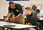 St. Louis County Police Lt. James Morgan (left) answers a question for Justin Bristol of Edwardsville prior to an assessment test at a Diversity Fair sponsored by the St. Louis County branch of the Ethical Society of Police. Morgan is also president of this branch of the ESOP. The fair was held at Hazelwood Central High School on Saturday August 11, 2018 with police agencies from ten different jurisdictions represented.   Photo by Tim Vizer