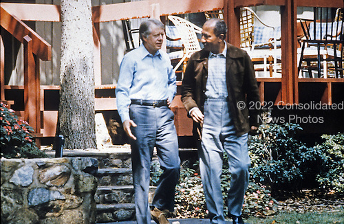 President Anwar al-Sadat of Egypt, right, and United States President Jimmy Carter, left, walk at Camp David, the US presidential retreat near Thurmont, Maryland during the Egypt-Israel Peace Summit in September, 1978..Credit: White House via CNP