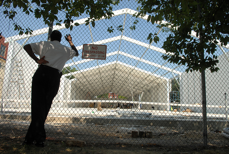 Curtis Wise from the Department of Consumer and Regulatory Affairs, watches a tour of the sight of a temporary structure that will house Eastern Market vendors.