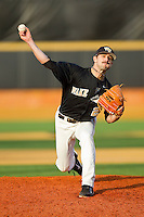 Michael Dimock #23 of the Wake Forest Demon Deacons in action against the Miami Hurricanes at Gene Hooks Field on March 19, 2011 in Winston-Salem, North Carolina.  Photo by Brian Westerholt / Four Seam Images