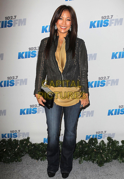 Carrie Ann Inaba.KIIS FM 2012 Jingle Ball - Night 2 held at Nokia Theatre L.A. Live, Los Angeles, California, USA..3rd December 2012 .full length jacket jeans denim leather brown yellow top clutch bag .CAP/ADM/KB.©Kevan Brooks/AdMedia/Capital Pictures.