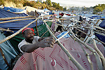 A man builds a new shelter in a camp for homeless families set up on a golf course in Port-au-Prince, Haiti, which was ravaged by a January 12 earthquake.