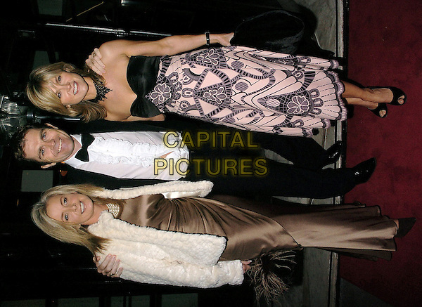 SALLY MEEN, GRAMT BOVEY & ANTHEA TURNER.At Childline's 18th Anniversary Birthday Ball, The Savvoy, London, November 20th 2004..full length married husband wife black and pink art deco prit strapless Temperley Temperly dress.Ref: CAN.www.capitalpictures.com.sales@capitalpictures.com.©Capital Pictures.
